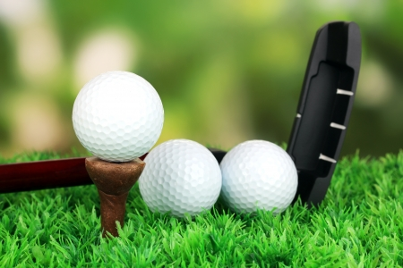 Golf ball and driver on green grass outdoor close up Stock Photo - 19654324