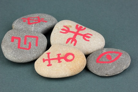 Fortune telling  with symbols on stones on grey background Stock Photo - 19654996