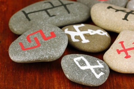 Fortune telling  with symbols on stones on wooden background Stock Photo - 19654935