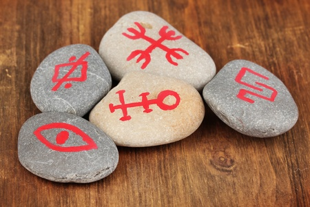 Fortune telling  with symbols on stones on wooden background Stock Photo - 19655095