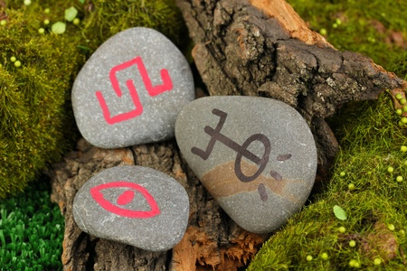 Fortune telling  with symbols on stone close up Stock Photo - 19655118
