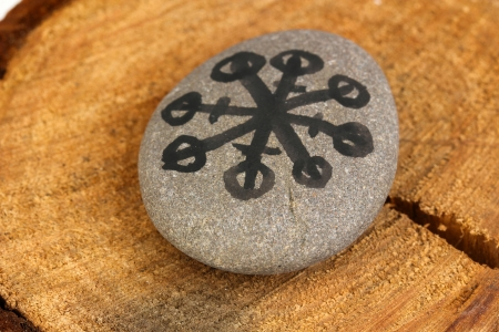 Fortune telling  with symbols on stone on wooden background Stock Photo - 19655122