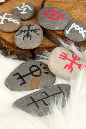 Fortune telling  with symbols on stones on white fur background Stock Photo - 19654992