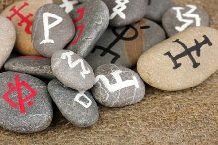 Fortune telling  with symbols on stones on burlap background Stock Photo - 19655098