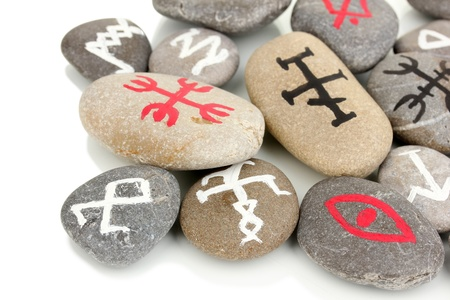 Fortune telling  with symbols on stones isolated on white Stock Photo - 19654763
