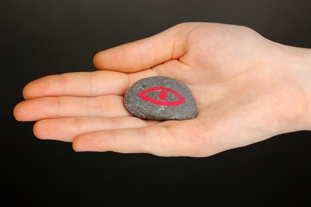 Fortune telling  with symbols on stone in hand on grey background Stock Photo - 19654358