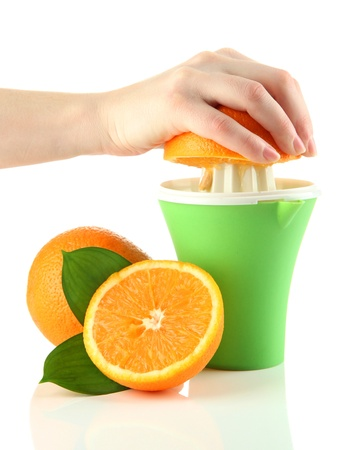 Preparing fresh orange juice squeezed with hand juicer, isolated on white photo