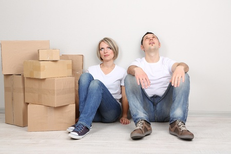Young couple moving in new house Stock Photo - 21522803