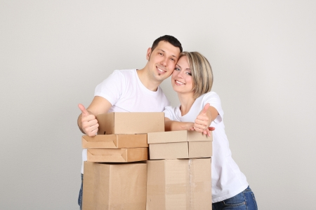Young couple moving in new house Stock Photo - 21522818