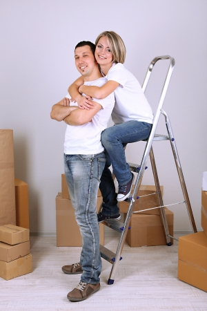 Young couple moving in new house Stock Photo - 21522887