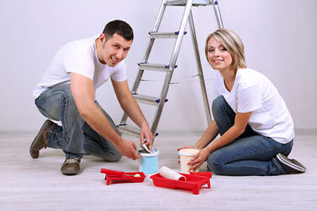 Young couple doing renovation together  photo