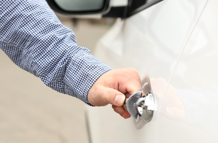 Man hand opening car door, close up photo