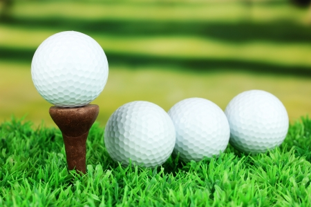 Golf balls on grass outdoor close up Stock Photo