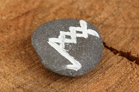 Fortune telling  with symbols on stone on wooden background photo