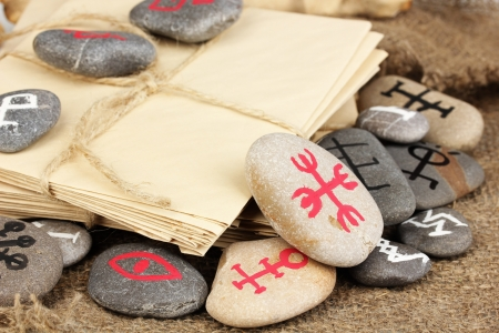 Fortune telling  with symbols on stones on burlap background Stock Photo - 19748284