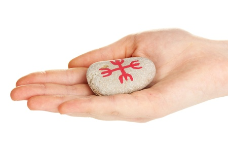 Fortune telling  with symbols on stone in hand isolated on white Stock Photo - 19763225