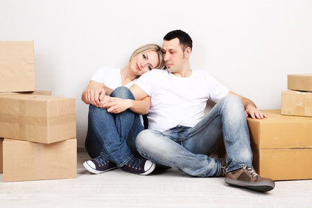 Young couple moving in new house Stock Photo - 21523859