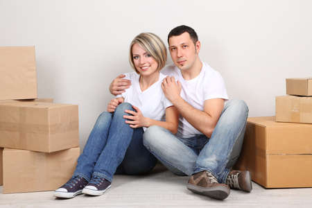 Young couple moving in new house Stock Photo - 21523972