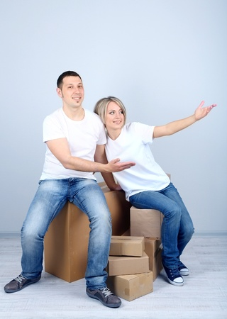 Young couple moving in new house Stock Photo - 21523973