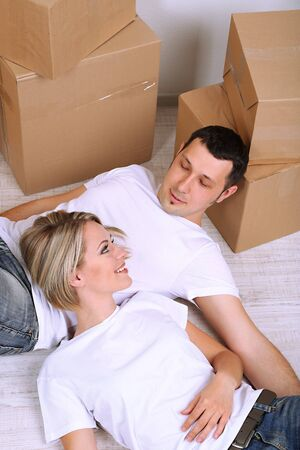 Young couple moving in new house Stock Photo - 21523957