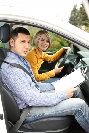 Learner driver student driving car with instructor photo
