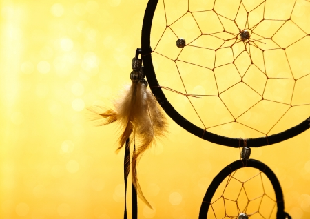 dreams: Beautiful dream catcher on yellow background