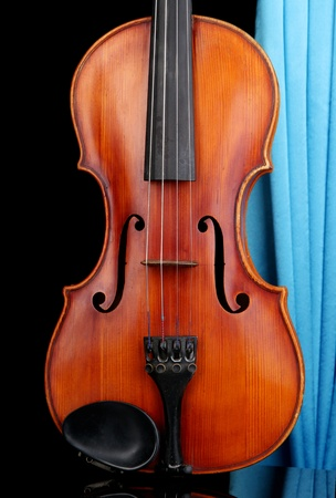 Classical violin on curtain background photo