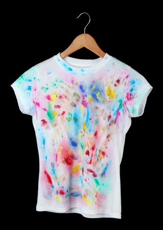 Bright t-shirt isolated on black photo