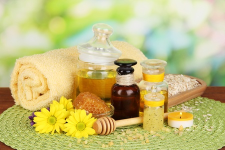 Fragrant honey spa with oils and honey on wooden table close-up photo