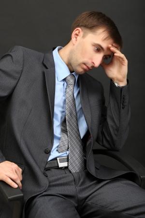 Young businessman ton black background Stock Photo - 21524325
