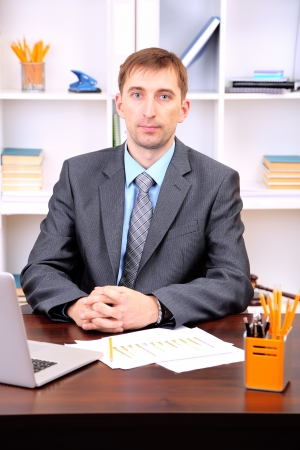 Young businessman in office at his workplace Stock Photo - 21524338