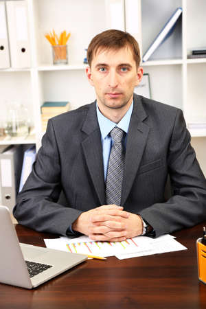 Young businessman in office at his workplace Stock Photo - 21524340