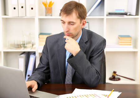 Young businessman in office at his workplace Stock Photo - 21524357