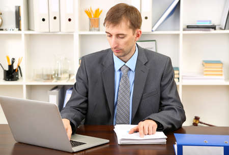 Young businessman in office at his workplace Stock Photo - 21524372