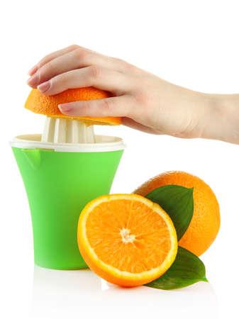 Preparing fresh orange juice squeezed with hand juicer, isolated on white photo