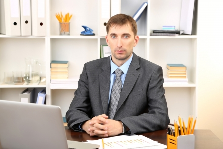 Young businessman in office at his workplace Stock Photo - 21524471