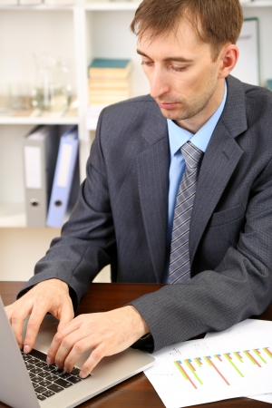 Young businessman in office at his workplace Stock Photo - 21524472
