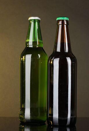 Bottles of beer on dark background photo