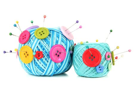 Colorful buttons and wool balls, isolated on white photo
