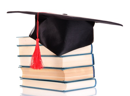alumna: Grad hat with books isolated on white
