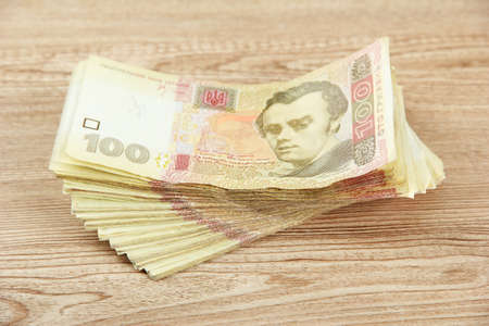 hryvna: Ukrainian money on wooden background