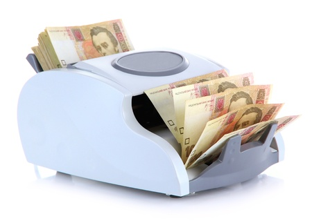 Machine for counting money with Ukrainian money, isolated on white photo