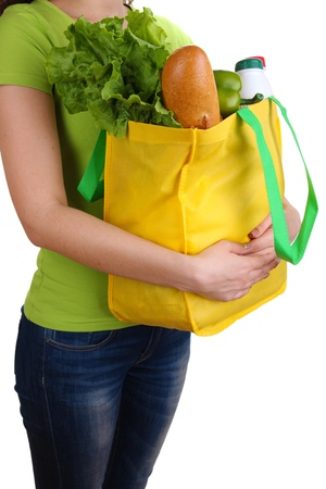 white fabric texture: Girl with shopping bag isolated on white Stock Photo