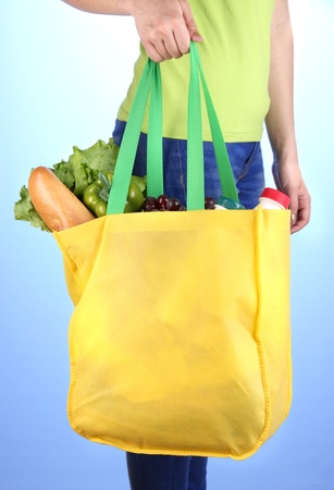 pone: Girl with shopping bag on blue background