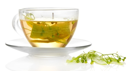Glass cup of tea with linden isolated on white photo