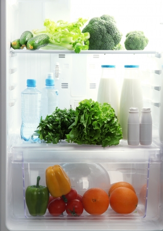 Open refrigerator with vegetarian food photo