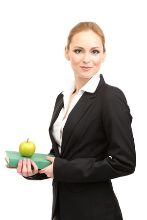 Portrait of teacher woman with book and apple, isolated on white photo