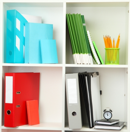 White office shelves with different stationery, close up Stock Photo - 19784873