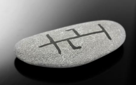 Fortune telling  with symbols on stone on black background Stock Photo - 19784955