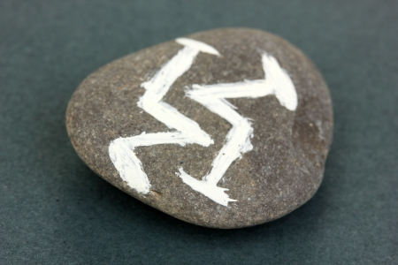 Fortune telling  with symbols on stone on grey background Stock Photo - 19786222